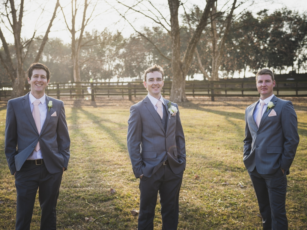 groomsmen in suits outside