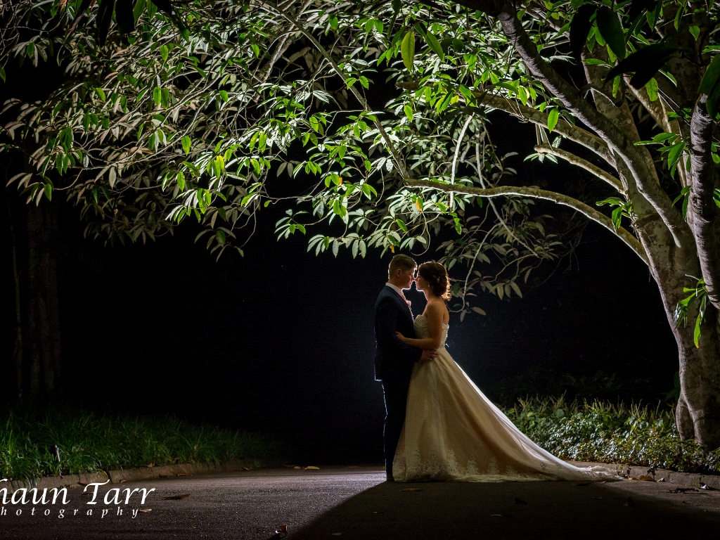 image of bride and groom outside at night