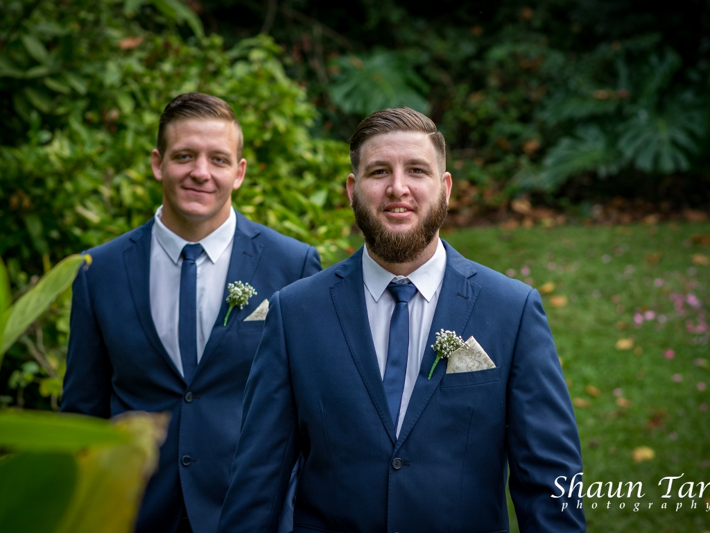 wedding photo of two groomsmen in suits