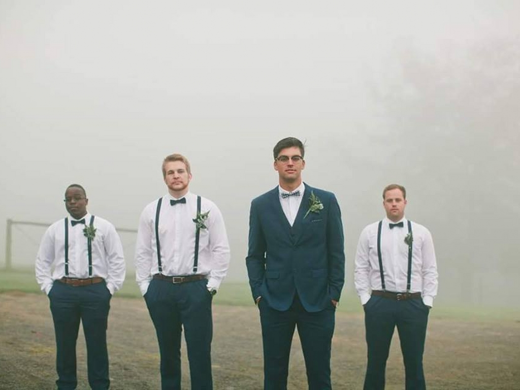 groom and groomsmen in a field