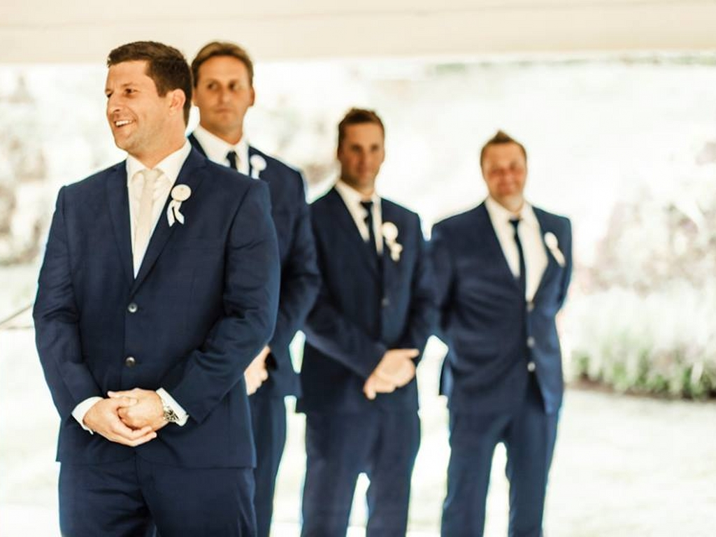 groom and his grooms men in suits