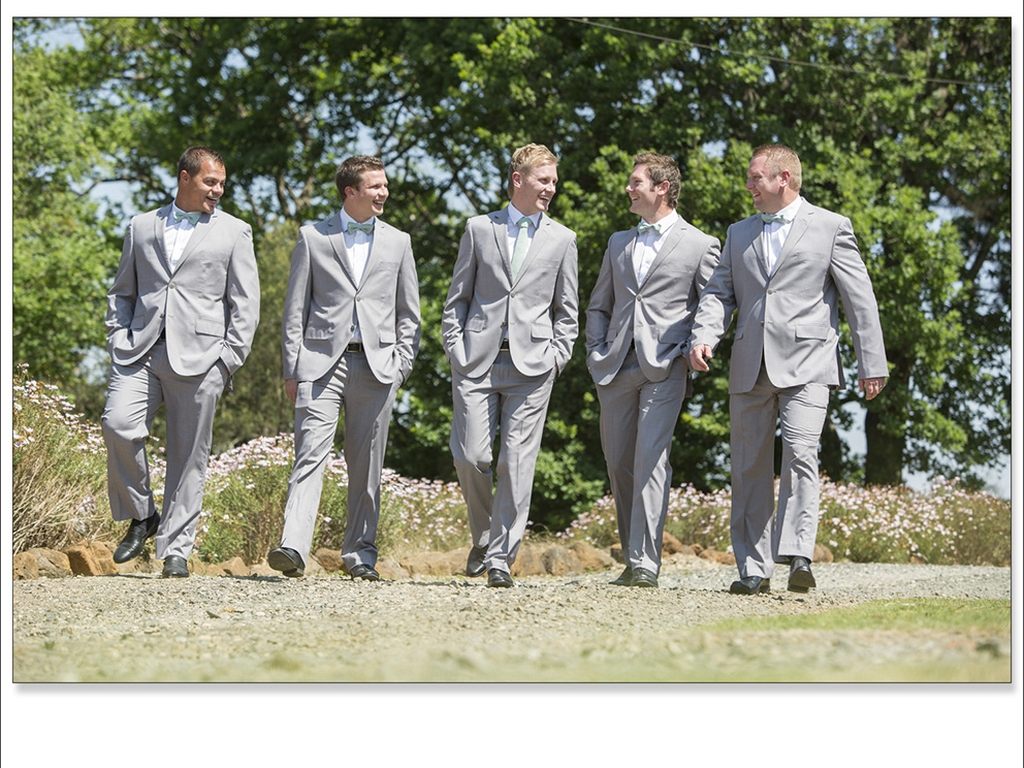 groom and groomsmen walking outside with each other