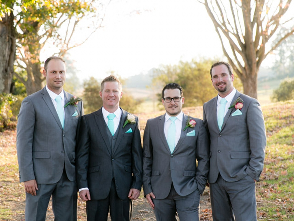 groom and groomsmen outside with suits on